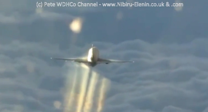 Chemtrail Planes caught in the act Masking the spray between the jet contrails